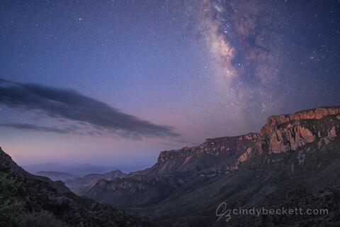 Milky Way rises above the southeastern wall of Juniper Canyon just as twilight begins to glow on the canyon walls.