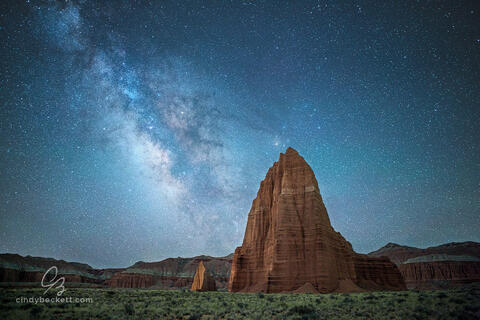 The Milky Way rises above the iconic monoliths, Temple of the Sun and Temple of the Moon, in Capitol Reef National Park, Utah.