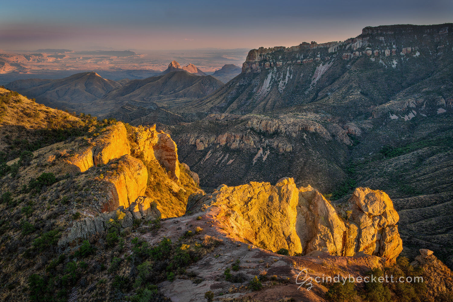 Sunset light captures rock faces of Juniper Canyon at the top of Lost Mine trail. Views across the canyon lead down into Pine Canyon and Sierra del Carmen