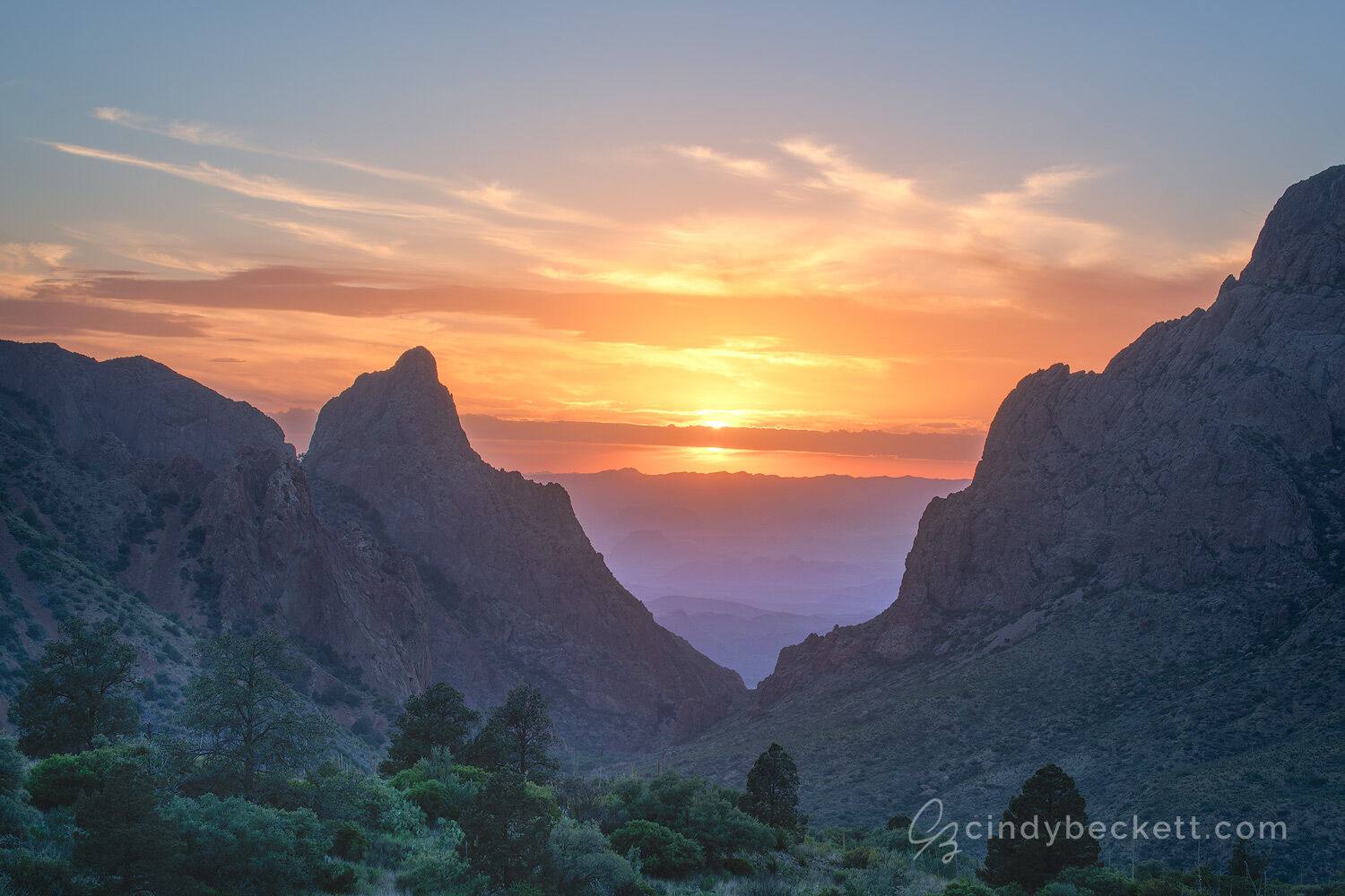 Sunset as viewed through The Window formation from the trail at Chisos Basin in Big Bend National Park.
